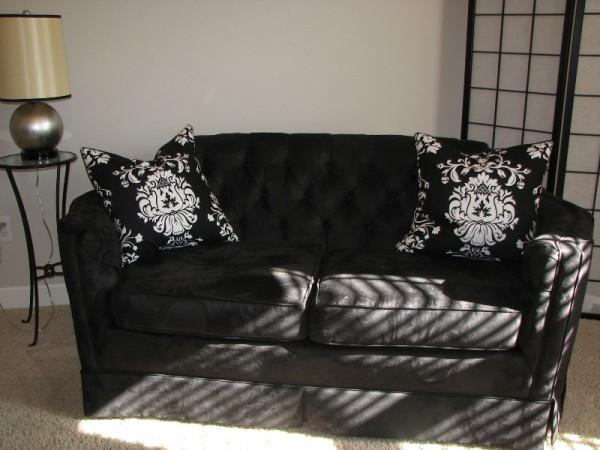 Re-Upholstered Black Loveseat